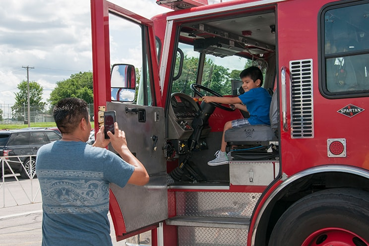 Kid in firetruck at SciFest