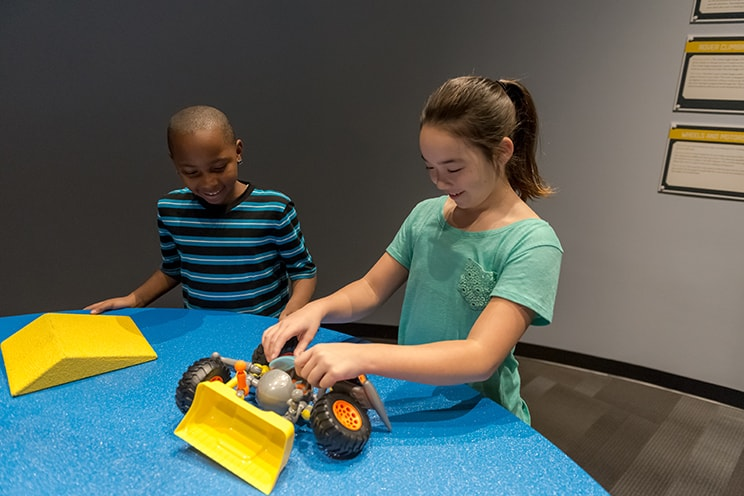 Boy and girl playing in Makerspace