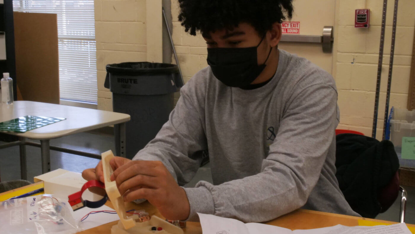 A YES Teen works on a project in the Engineering component